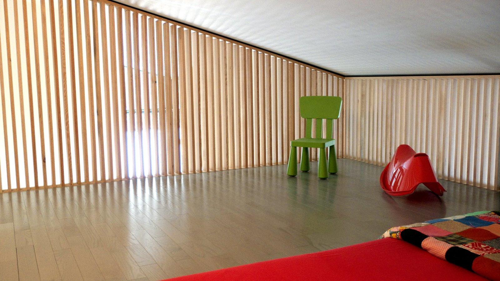 Bedroom, Bed, Ceiling Lighting, and Medium Hardwood Floor  Pioneer Cabin