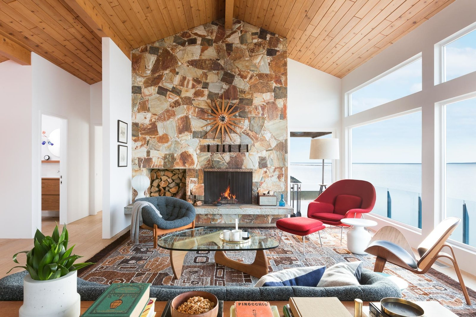 Living Room, End Tables, Wood Burning Fireplace, Chair, Floor Lighting, Sofa, Medium Hardwood Floor, and Coffee Tables  Halfmoon Bay House by Falken Reynolds Interiors