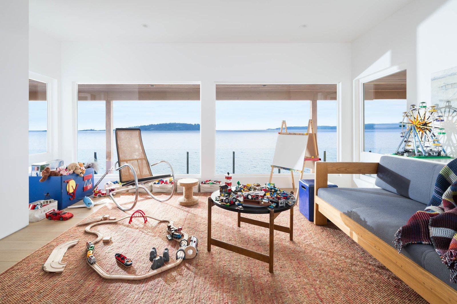 Kids Room, Rug Floor, Light Hardwood Floor, and Playroom Room Type  Halfmoon Bay House by Falken Reynolds Interiors
