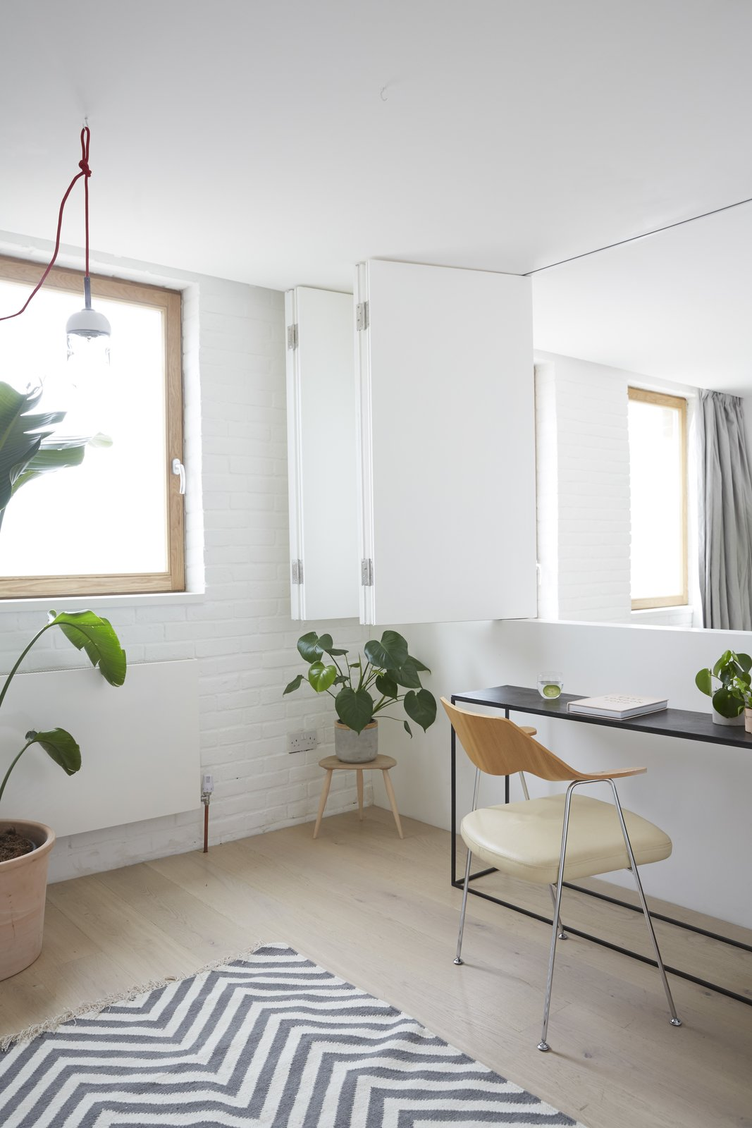 The flexible home-office space overlooks the living room below