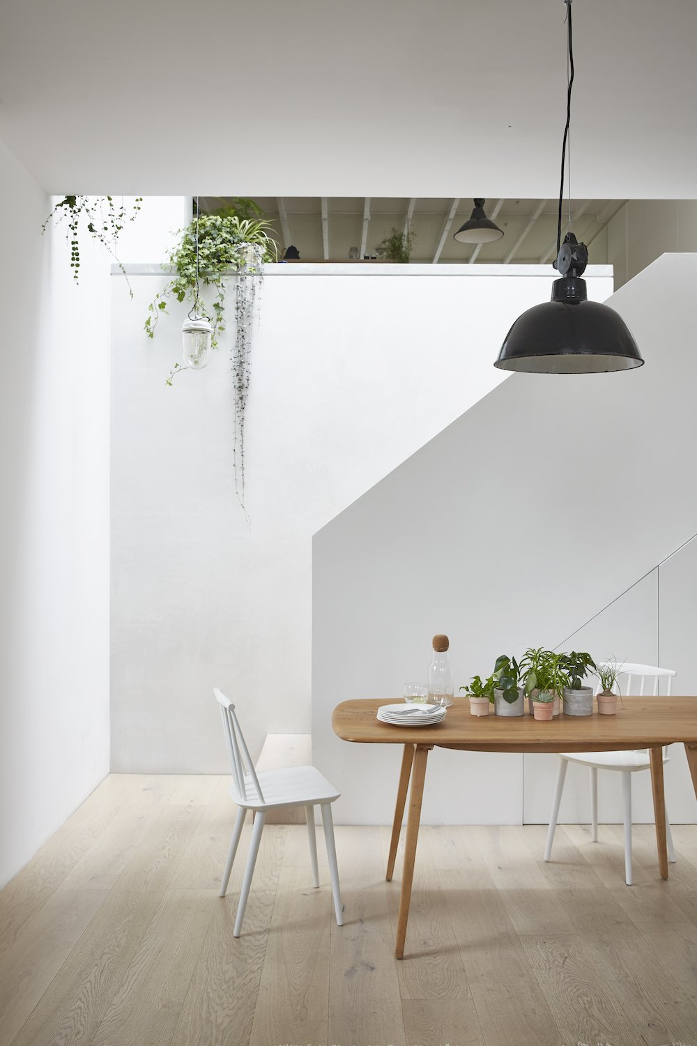 A new staircase and roof light, brings natural light into the dining area, overlooked by the kitchen above