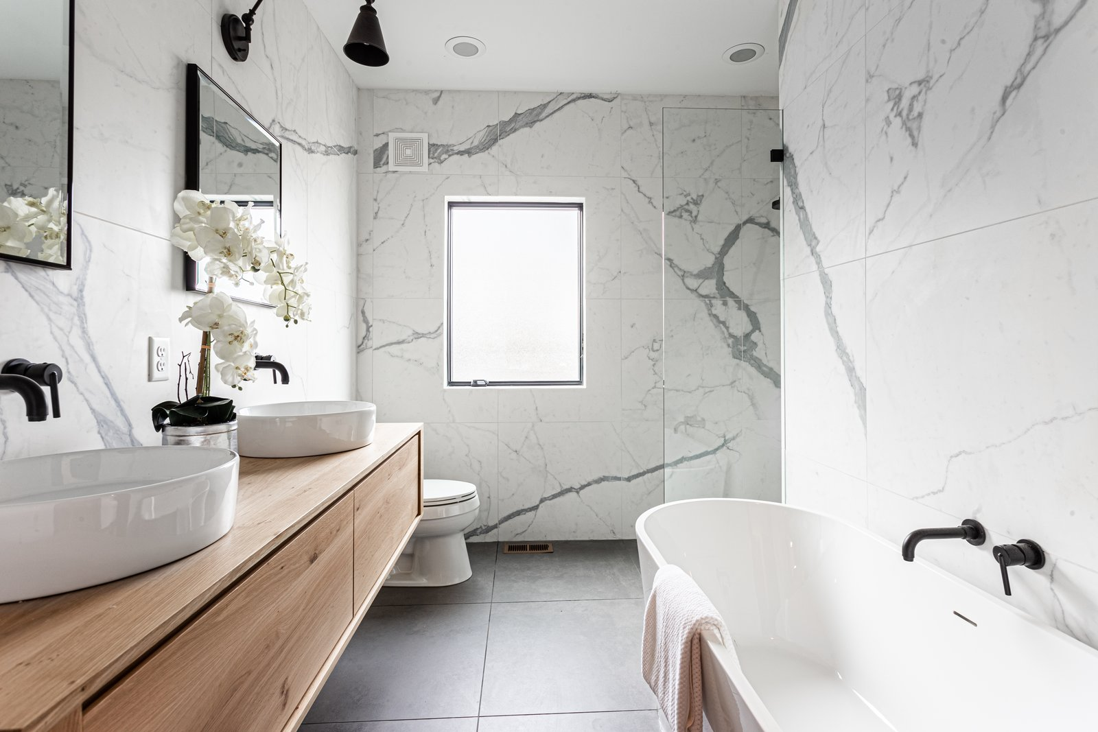 Bath Room, One Piece Toilet, Open Shower, Stone Tile Wall, Wall Lighting, Freestanding Tub, Vessel Sink, Wood Counter, and Recessed Lighting  Bathrooms