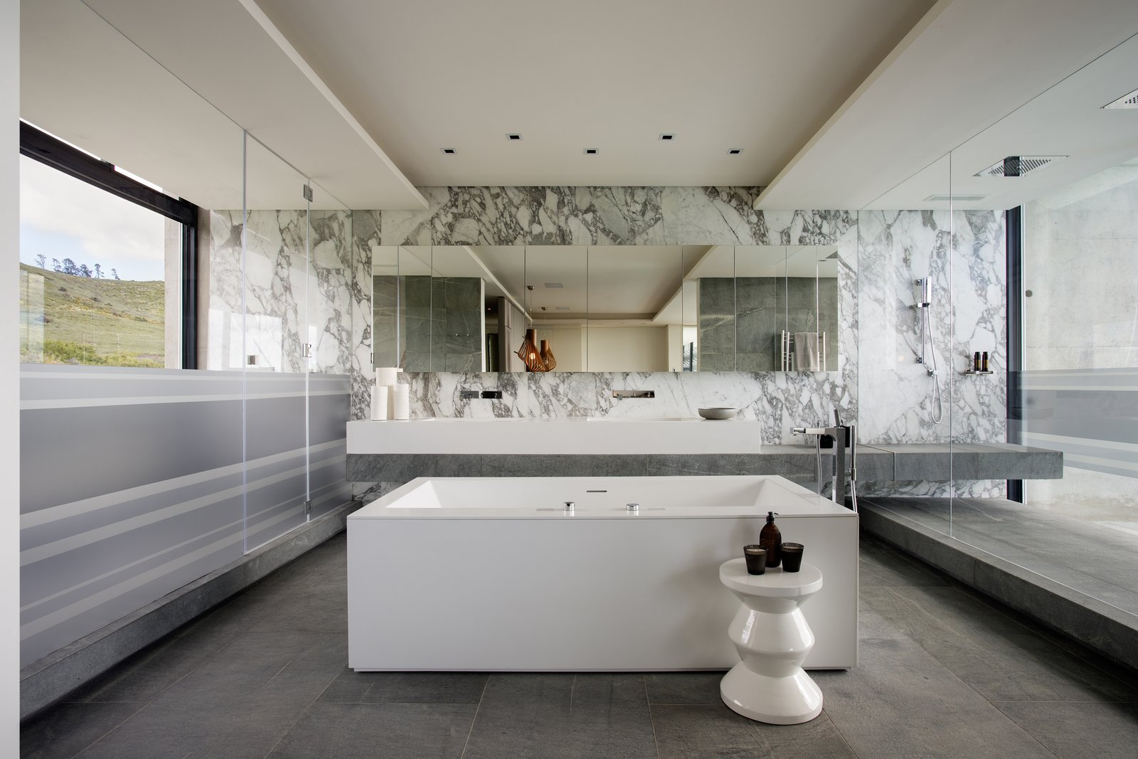 Bath Room, Freestanding Tub, Undermount Sink, Full Shower, Corner Shower, Ceramic Tile Floor, Marble Wall, Granite Counter, Marble Counter, Concrete Counter, and Recessed Lighting  Photo 1 of 5 in Top 5 Homes of the Week With Blissful Bathrooms from City Villa