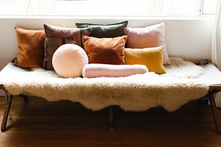Textiles and warm, bohemian hues are important to Julia. She styled a vintage army cot with pillows from friends at Campaign Living.