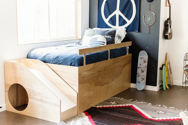 Before Gram's little sister arrived, Dusty built him this custom bed to help him let go of the crib. In addition to the slide, there's a secret hideout.  Photo 14 of 15 in Too Cool: This Boho Surf Shack Has a Half-Pipe in the Backyard
