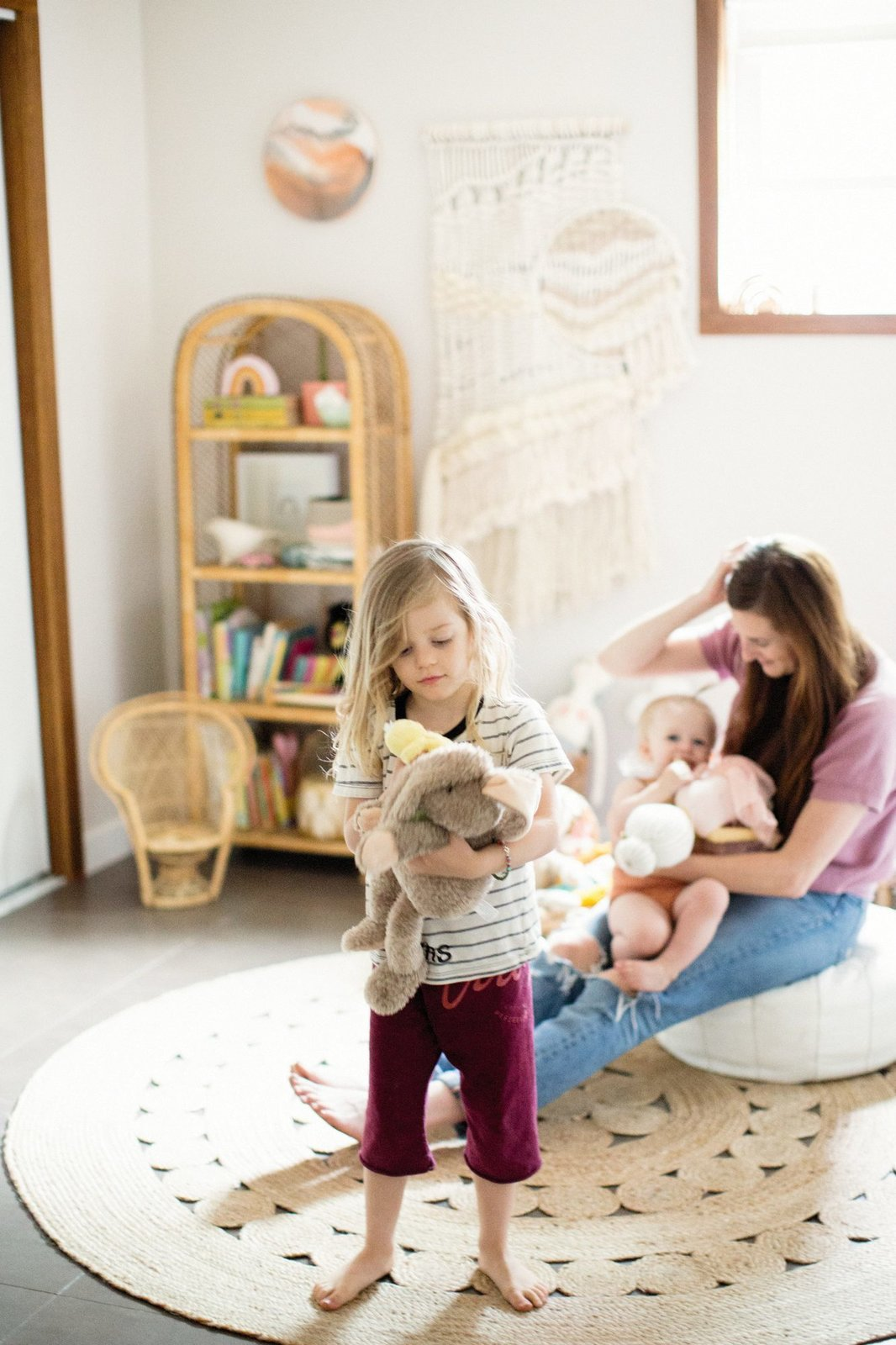 Kids Room, Rug Floor, Neutral Gender, and Toddler Age The nursery, with its muted, natural tones and textures is filled with wicker and macrame accessories.  Photo 15 of 15 in Too Cool: This Boho Surf Shack Has a Half-Pipe in the Backyard
