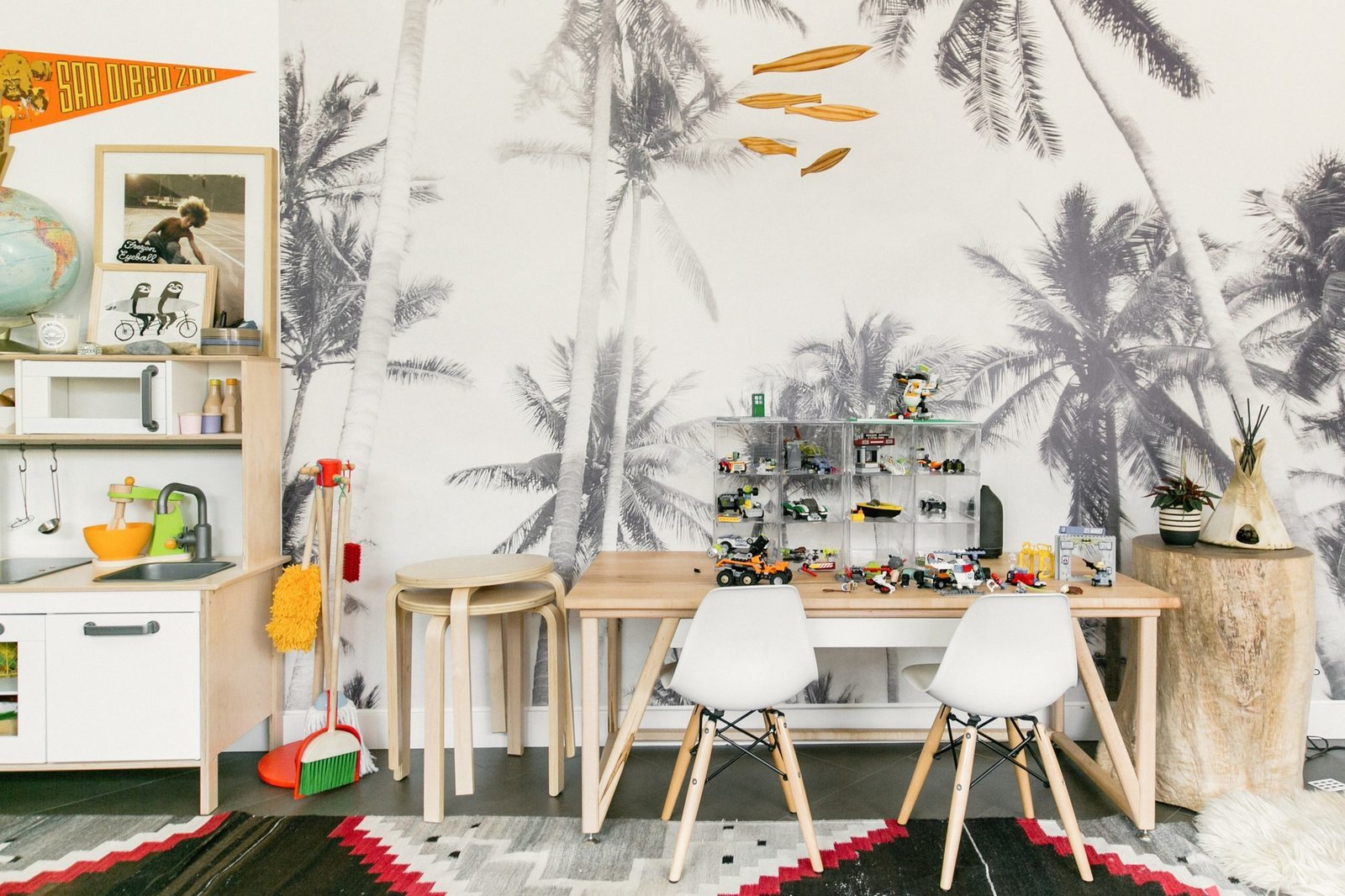 Kids Room, Chair, Desk, Playroom Room Type, and Rug Floor The custom Lego table reflects a lot of Rael Made designs — clean, simple, modern.  Photo 7 of 15 in Too Cool: This Boho Surf Shack Has a Half-Pipe in the Backyard