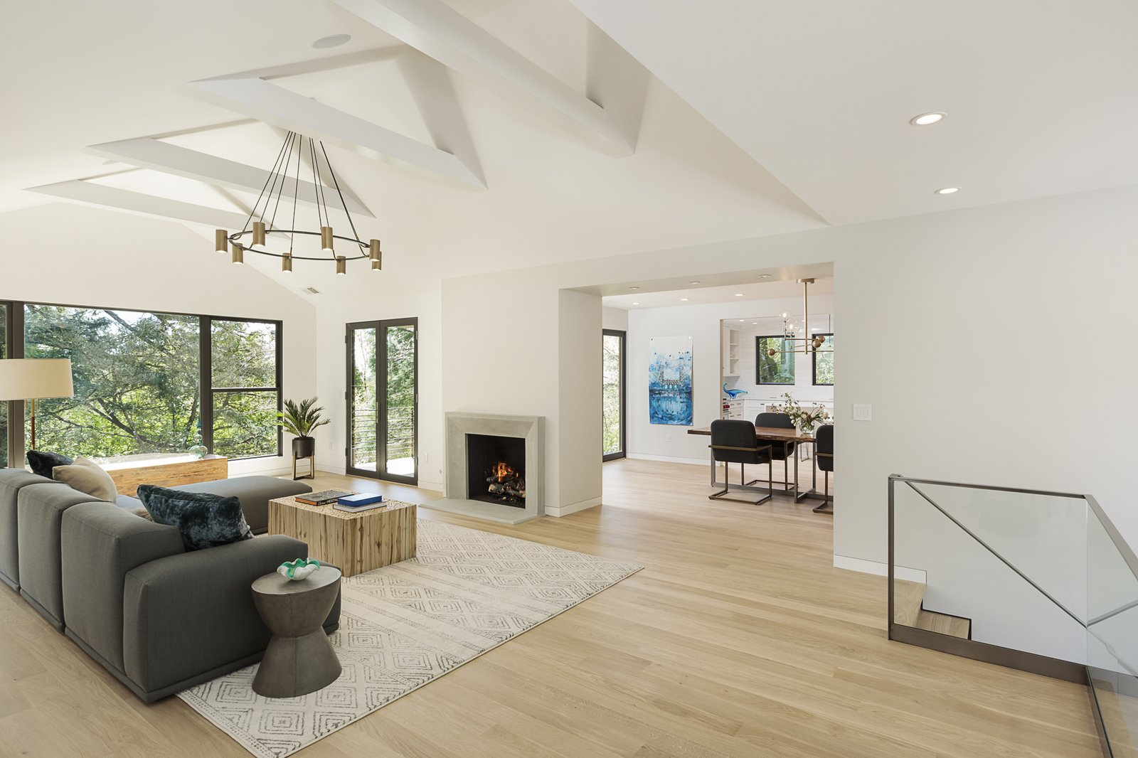 Living Room, Light Hardwood Floor, Recessed Lighting, Gas Burning Fireplace, and Ceiling Lighting  Burton House