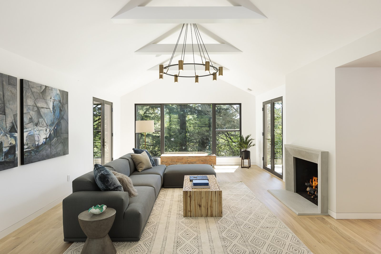 Living Room, Gas Burning Fireplace, Ceiling Lighting, and Light Hardwood Floor  Burton House