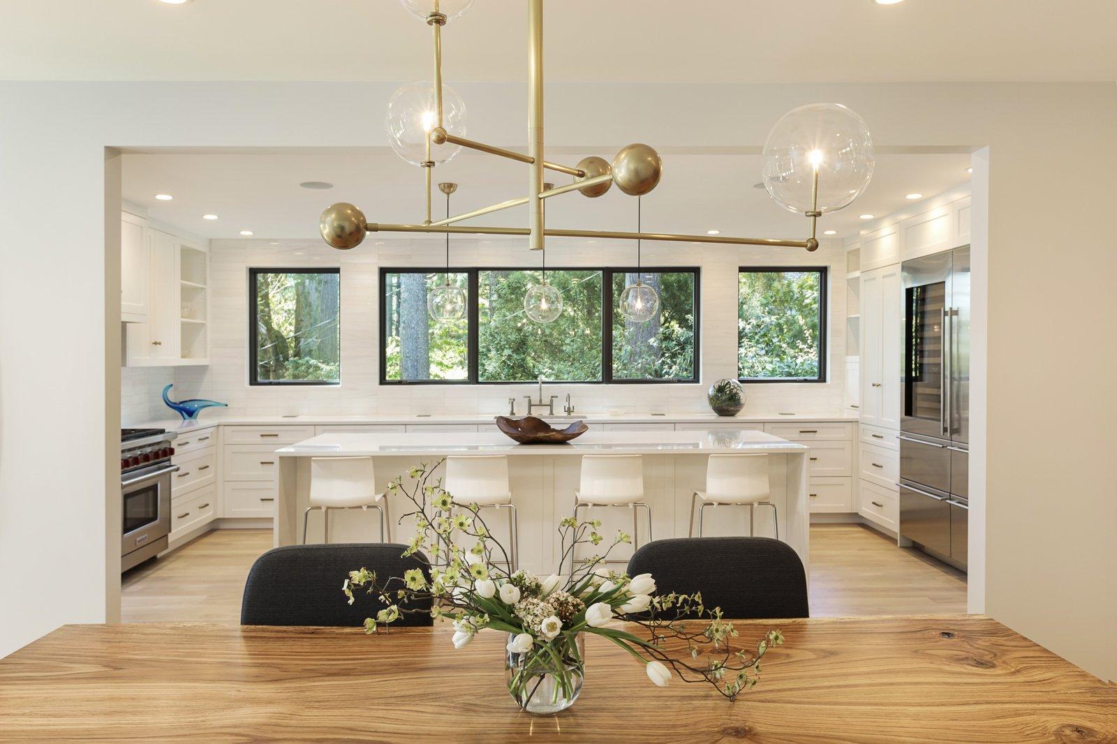 Dining Room, Light Hardwood Floor, Ceiling Lighting, and Recessed Lighting  Burton House