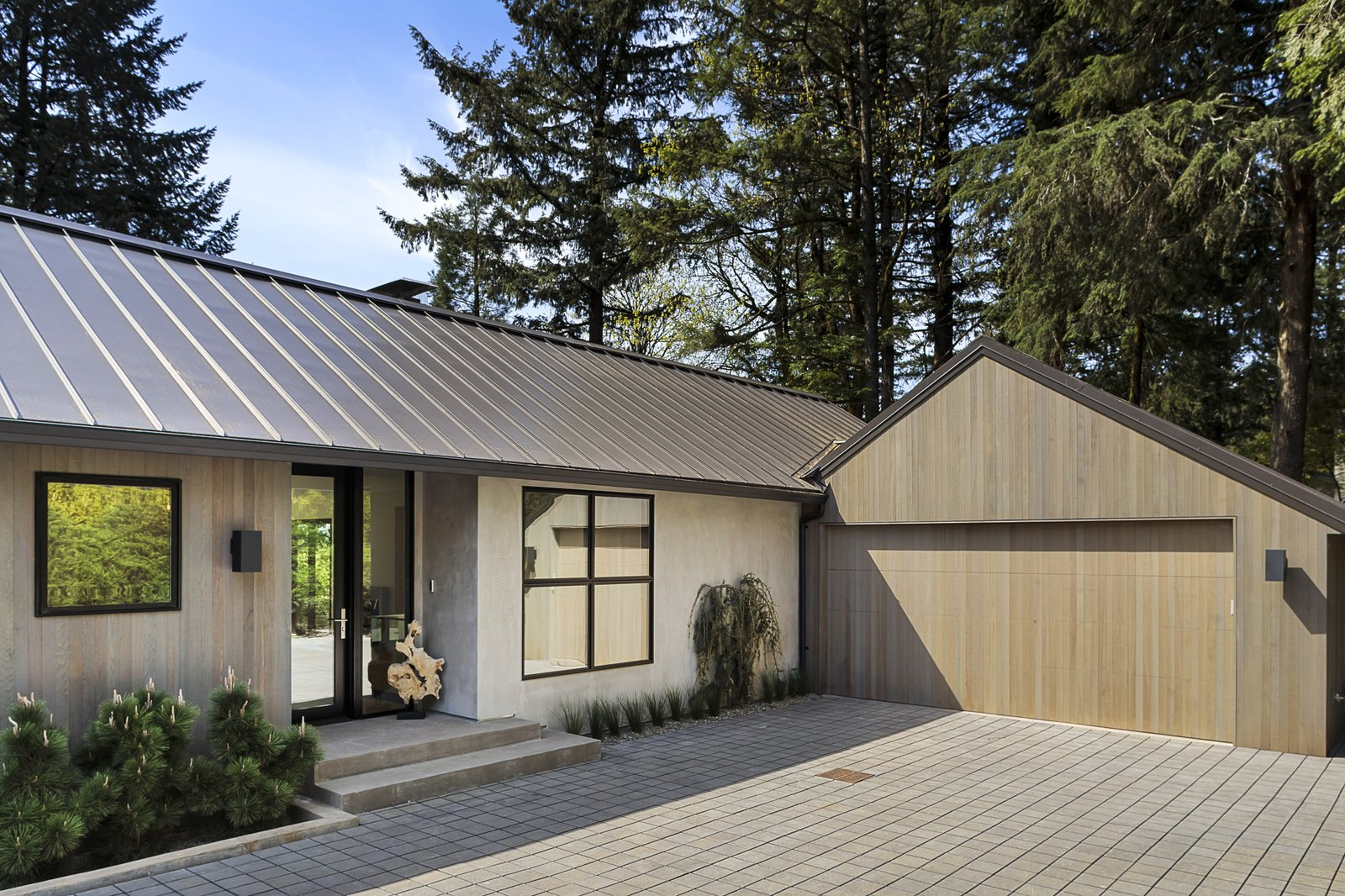 Exterior, Concrete Siding Material, Metal Roof Material, House Building Type, and Wood Siding Material  Burton House