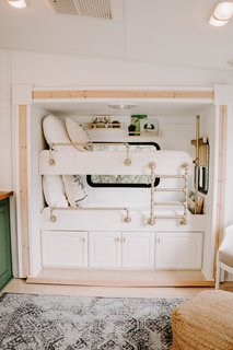 To maximize space, they added bunk beds to an area that was previously a slide-out entertainment center, and also included storage underneath.
