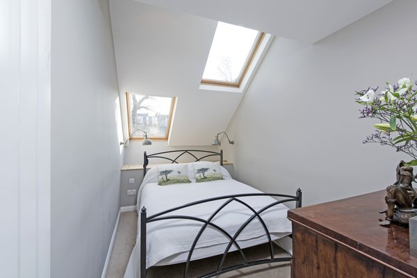 The master bedroom has a dressing room and an en-suite bathroom, giving it the feeling of a private suite.