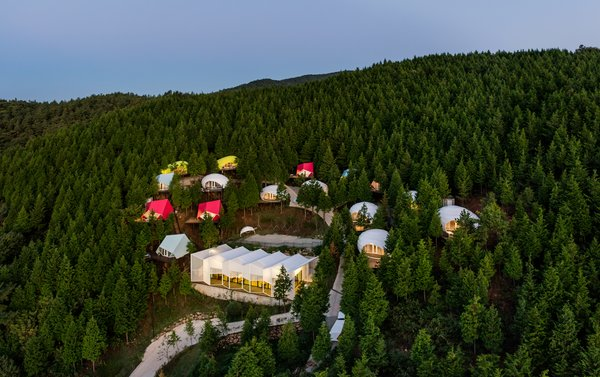 Colorful Glamping Pods Dot a Forest in South Korea