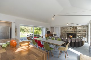 The only feature that remains of the original home is the end gable wall. For the renovation, the stone on this wall has been left exposed. This feature, along with the wood-burning stove at the chimney area, are now the focal points of the living space.