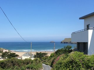 The house has uninterrupted views over the village of Polzeath and its sandy beach and bay, which is a surfing hotspot.