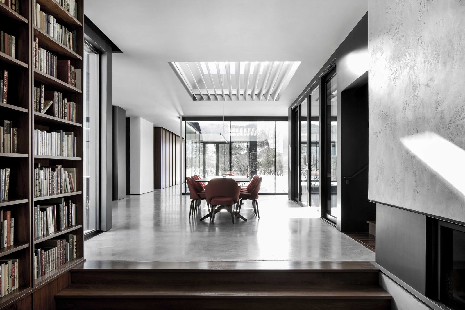 Dining Room, Concrete Floor, Corner Fireplace, Chair, and Table  True North by Alain Carle Architecte
