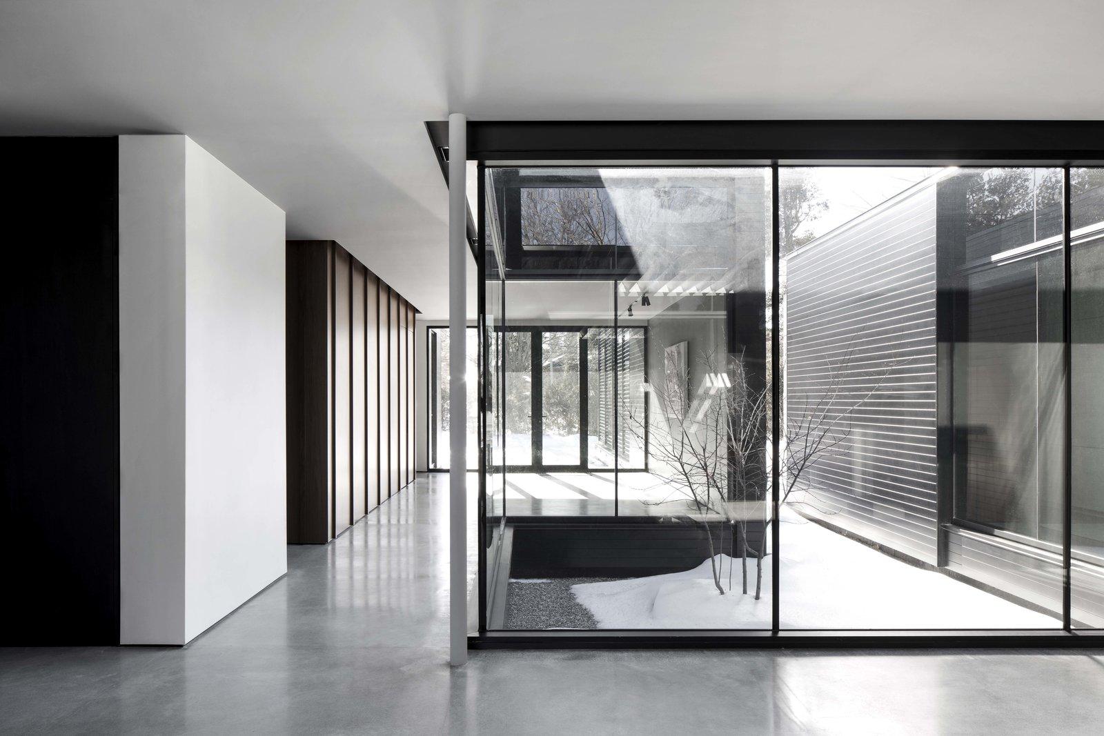 Hallway and Concrete Floor  True North by Alain Carle Architecte