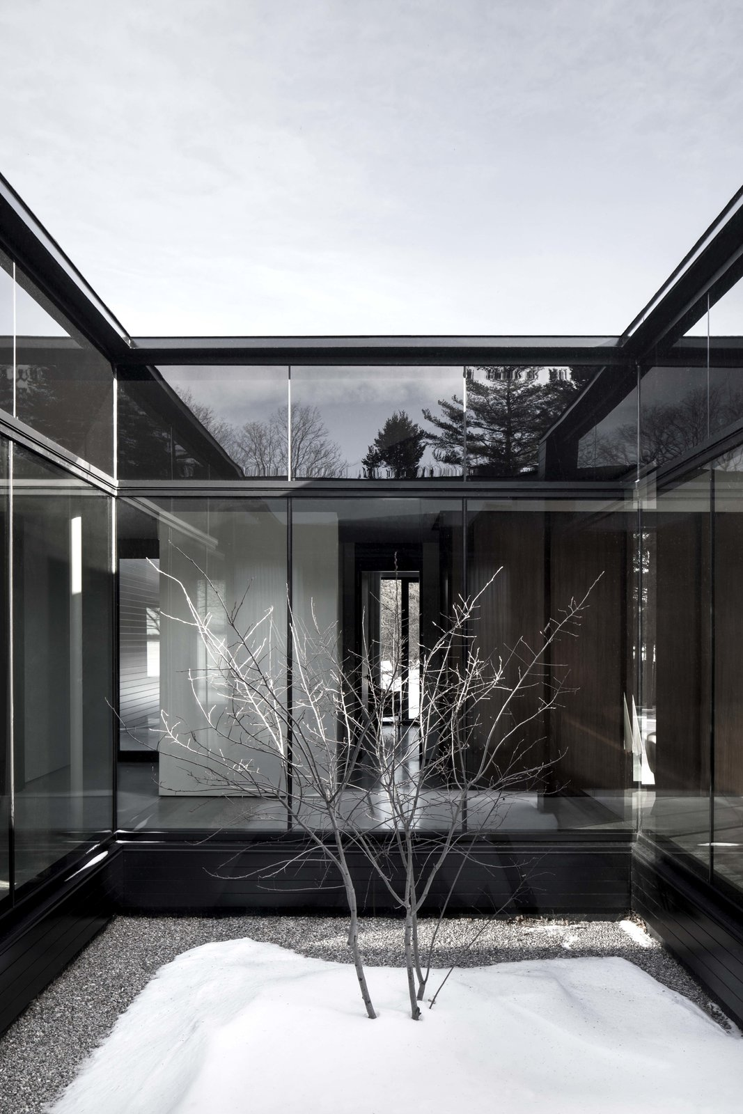 Exterior, Glass Siding Material, House Building Type, and Flat RoofLine  True North by Alain Carle Architecte