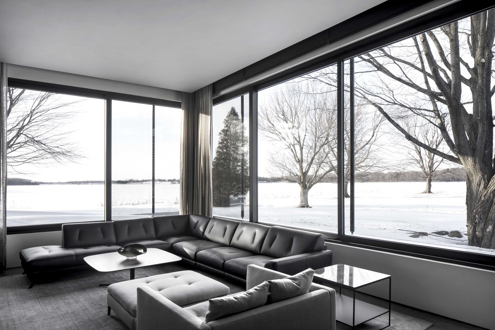 Living Room, Sectional, and Concrete Floor  True North by Alain Carle Architecte