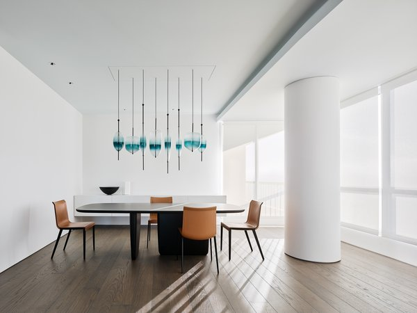 Dining Room, Chair, Medium Hardwood Floor, Table, and Pendant Lighting  Best Photos from Private Residence 4