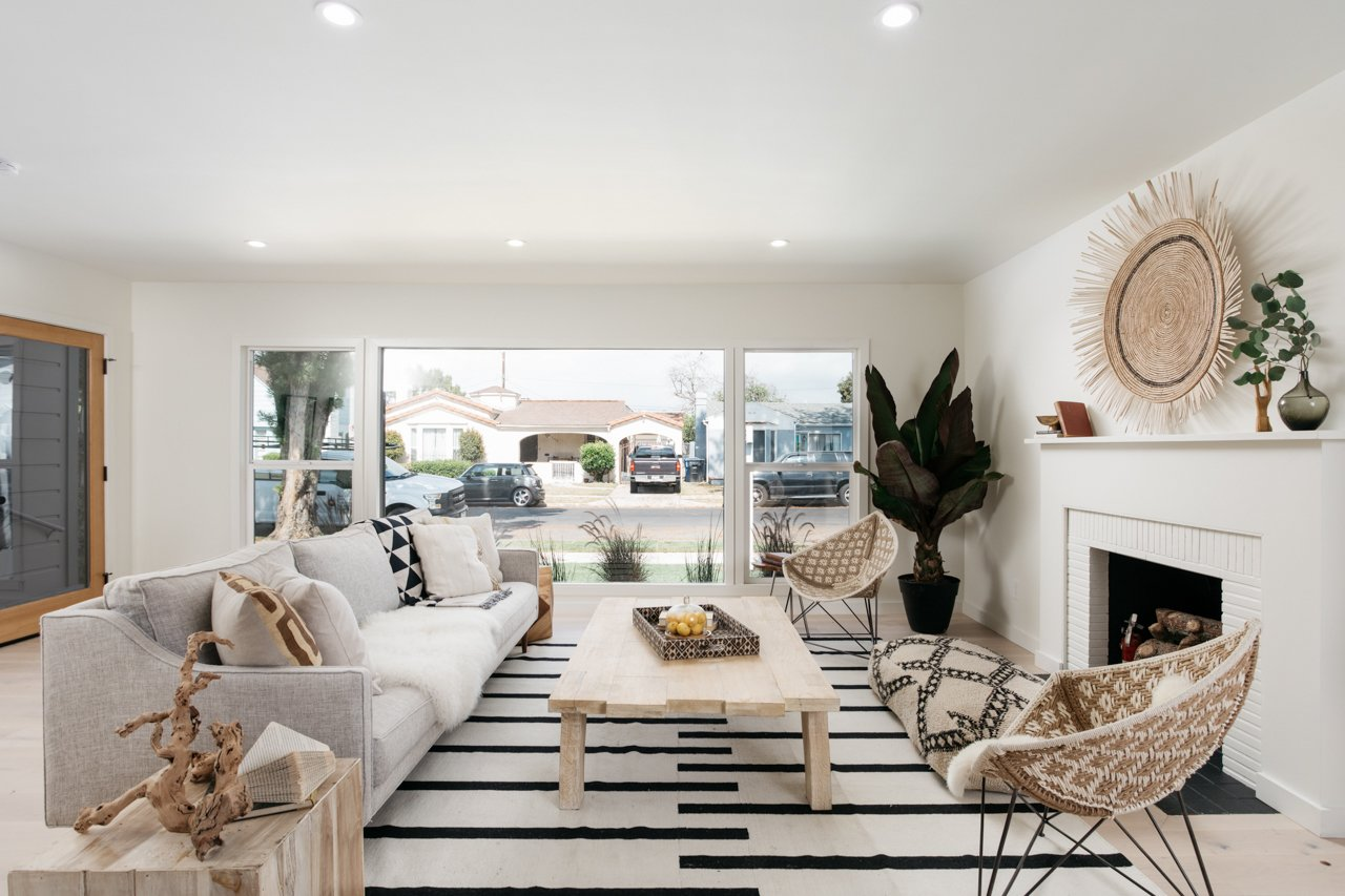 Living Room, Recessed Lighting, Sofa, Coffee Tables, Standard Layout Fireplace, Chair, Light Hardwood Floor, Gas Burning Fireplace, and End Tables  Olmsted By MINI INNO