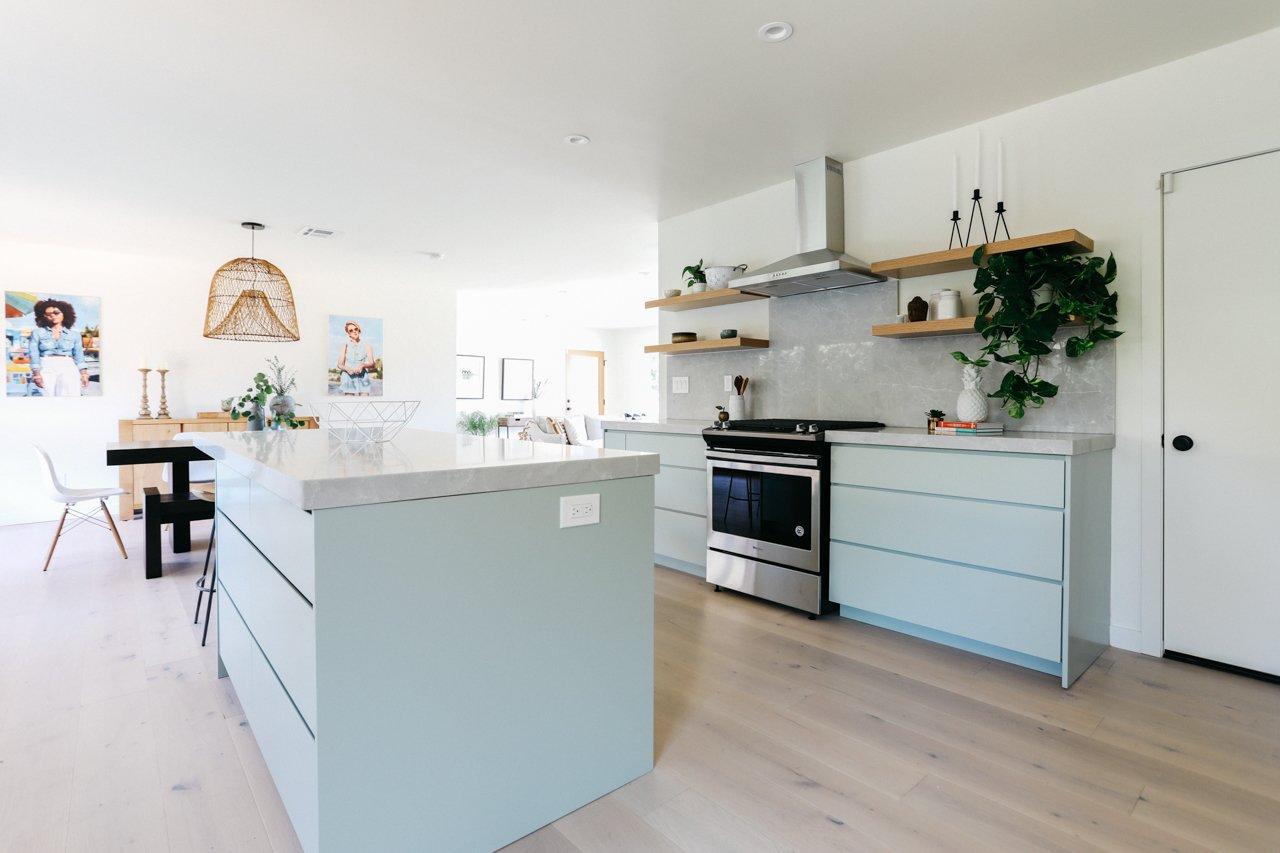 Kitchen, Light Hardwood Floor, Open Cabinet, Stone Counter, Wood Cabinet, Stone Slab Backsplashe, Recessed Lighting, Range, Engineered Quartz Counter, Range Hood, and Undermount Sink  Olmsted By MINI INNO