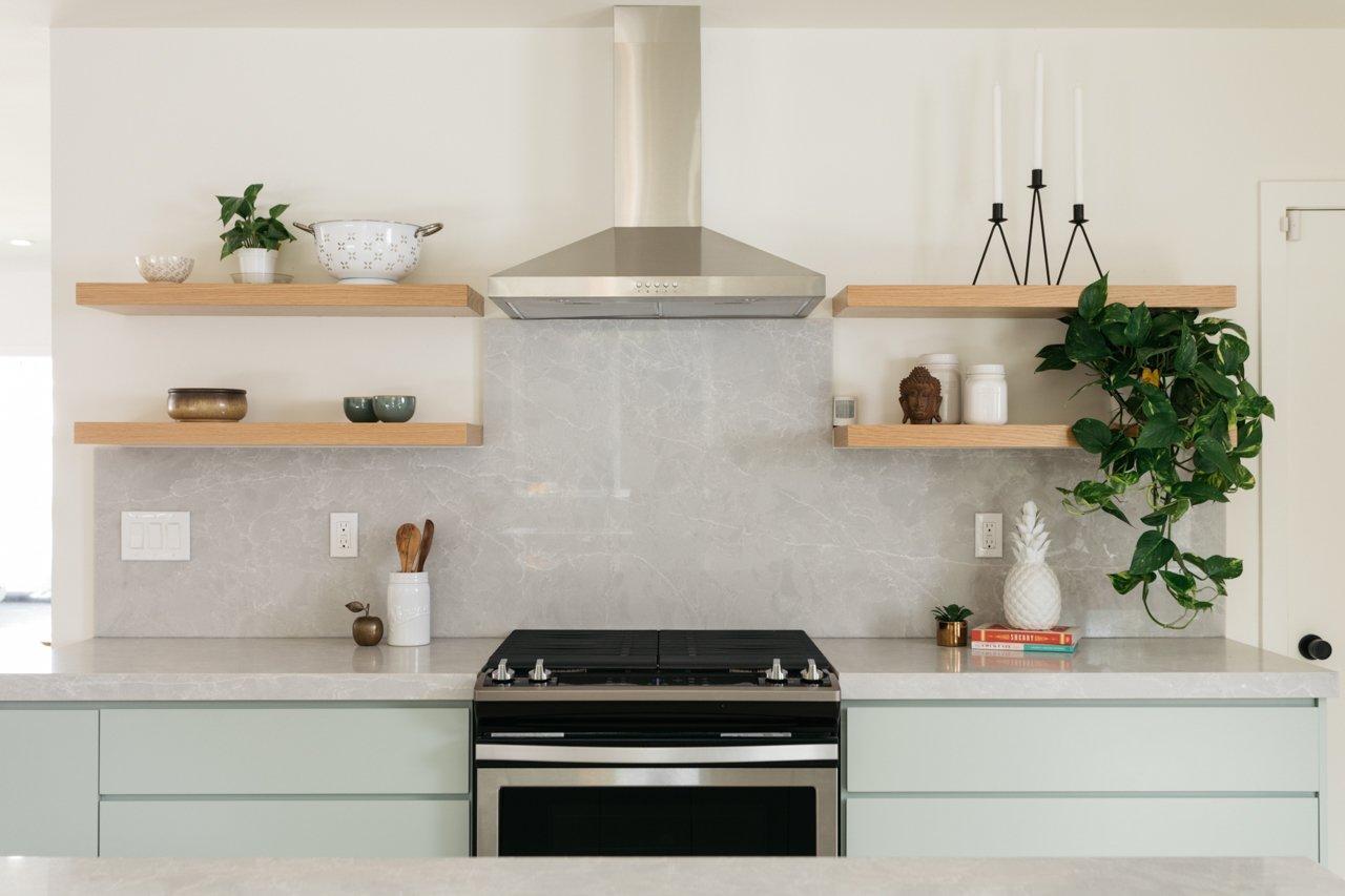 Kitchen, Undermount Sink, Range Hood, Range, Stone Slab Backsplashe, Wood Cabinet, Recessed Lighting, and Open Cabinet  Olmsted By MINI INNO