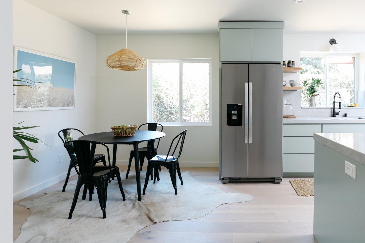 Kitchen, Undermount Sink, Accent Lighting, Wood Cabinet, Pendant Lighting, Refrigerator, Engineered Quartz Counter, and Stone Slab Backsplashe  Olmsted By MINI INNO