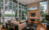 Modern home with Living Room, Light Hardwood Floor, Wood Burning Fireplace, Coffee Tables, Chair, Sectional, and Sofa. Photo 5 of Modern & Minimalist on Lake Wisconsin