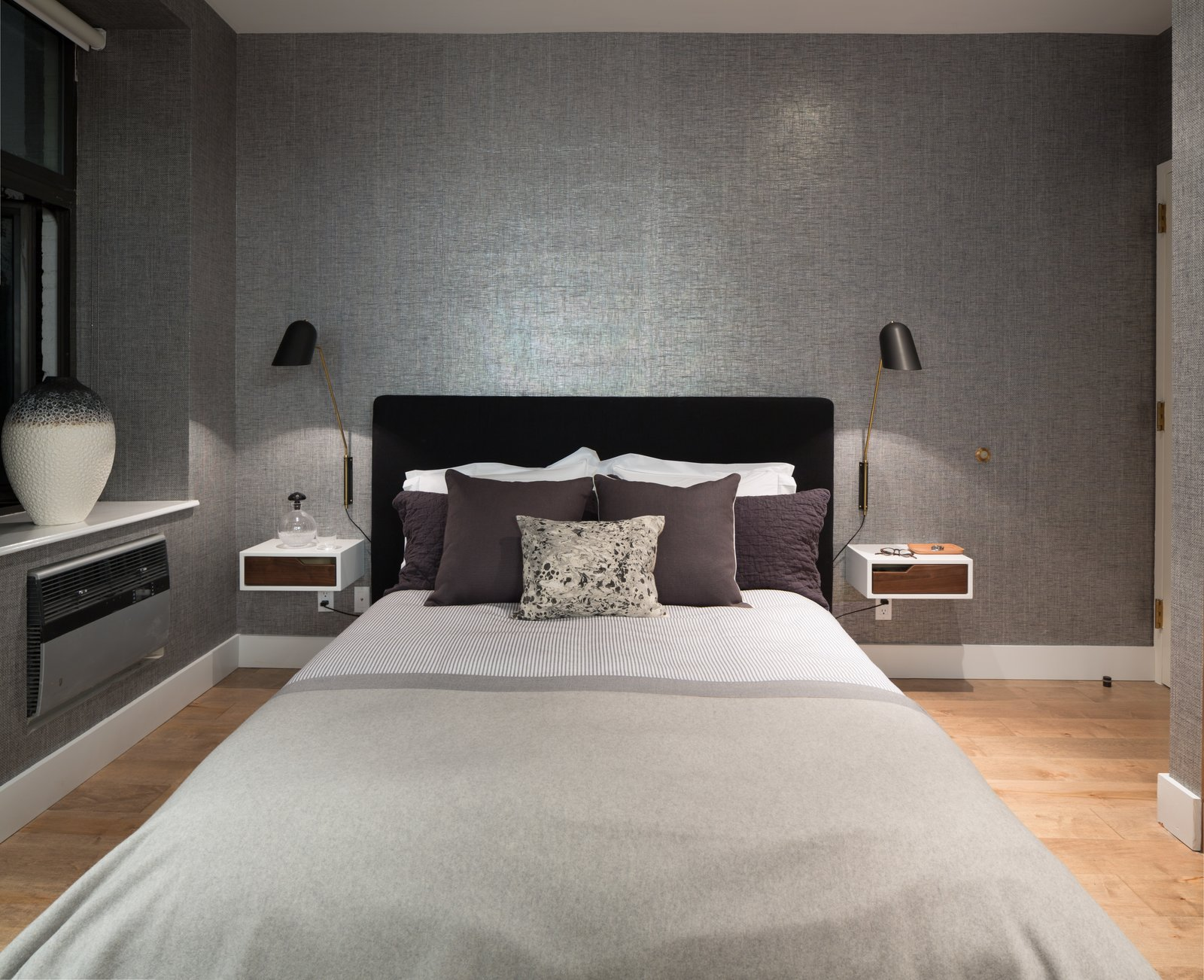 Bedroom, Bed, Night Stands, Wall, and Light Hardwood  Best Bedroom Night Stands Wall Photos from Renovated SoHo Duplex