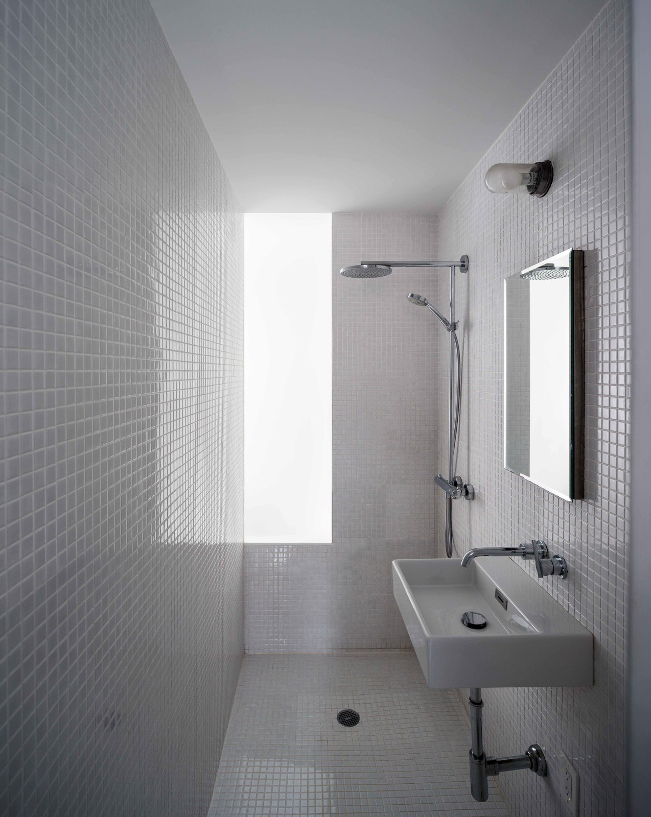 Bath Room, Porcelain Tile Floor, One Piece Toilet, Open Shower, Wall Mount Sink, Ceramic Tile Wall, and Recessed Lighting  Photos from Ridgewood Townhouse