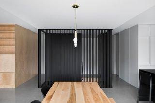 Lambert & Fils' Dot Line Suspension lamp hangs over an Allais Table by The Gaspé.
