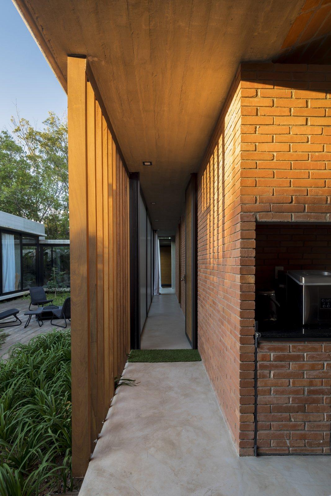 Hallway, Dark Hardwood Floor, and Concrete Floor  Photos from Patios House