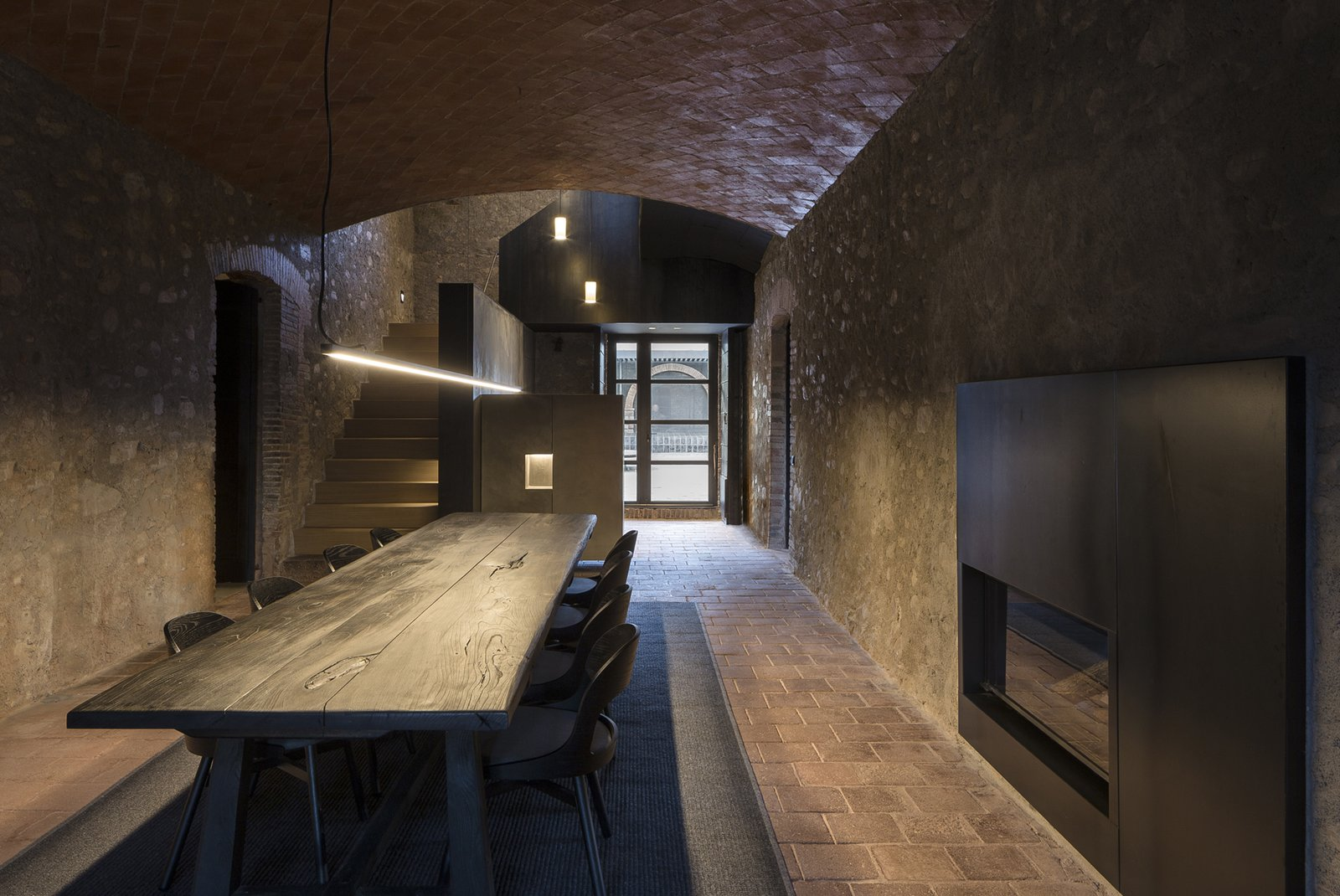 Dining Room, Lamps, Table, Two-Sided Fireplace, Ceramic Tile Floor, and Pendant Lighting  Sant Martí House by Francesc Rifé Studio