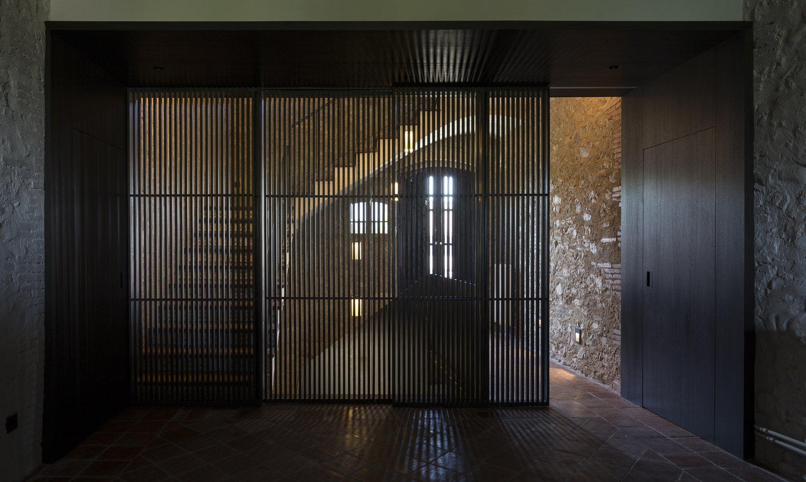 Hallway and Ceramic Tile Floor  Sant Martí House by Francesc Rifé Studio