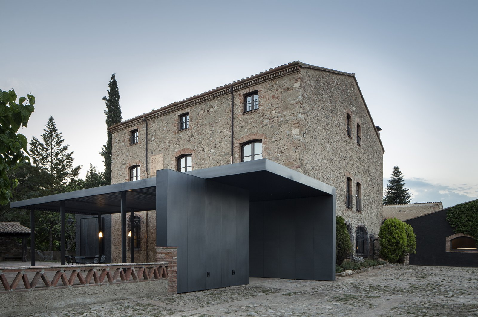 Exterior, Metal Siding Material, Shingles Roof Material, Farmhouse Building Type, and House Building Type  Sant Martí House by Francesc Rifé Studio