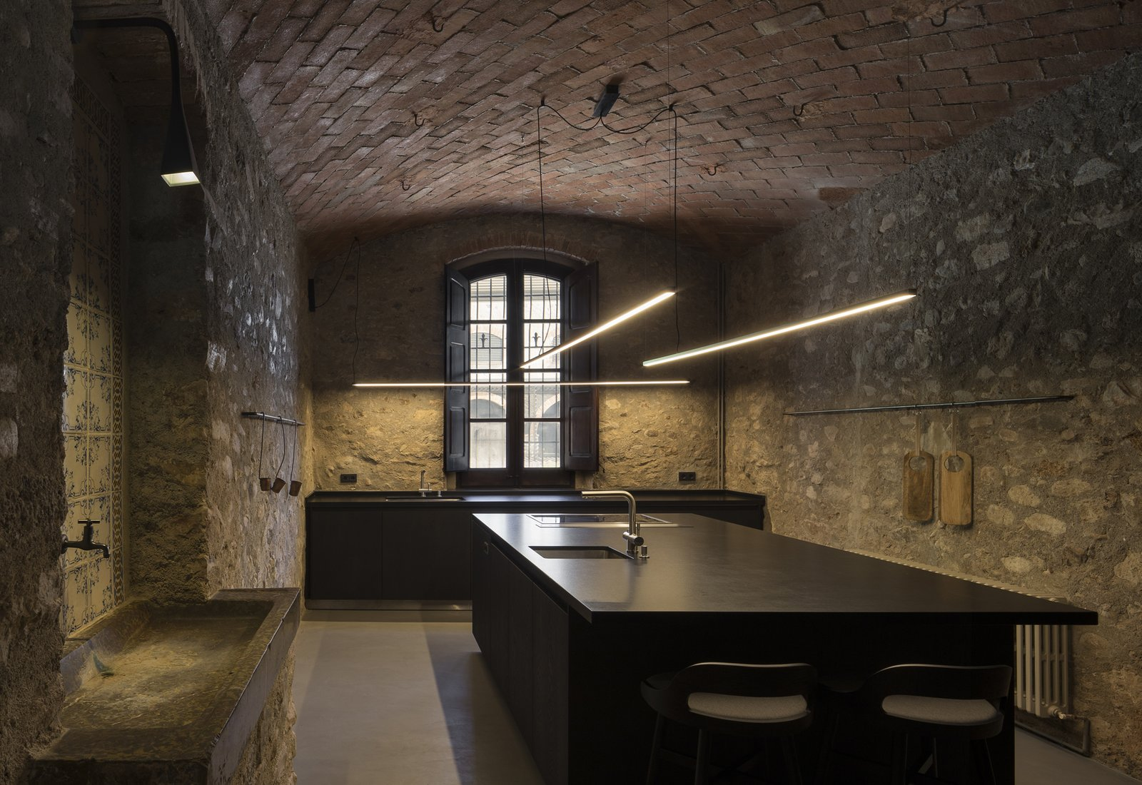 Kitchen, Range Hood, Wall, Concrete, Stone Tile, Undermount, Granite, Wood, Wood, and Pendant  Best Kitchen Concrete Undermount Wood Photos from Sant Martí House