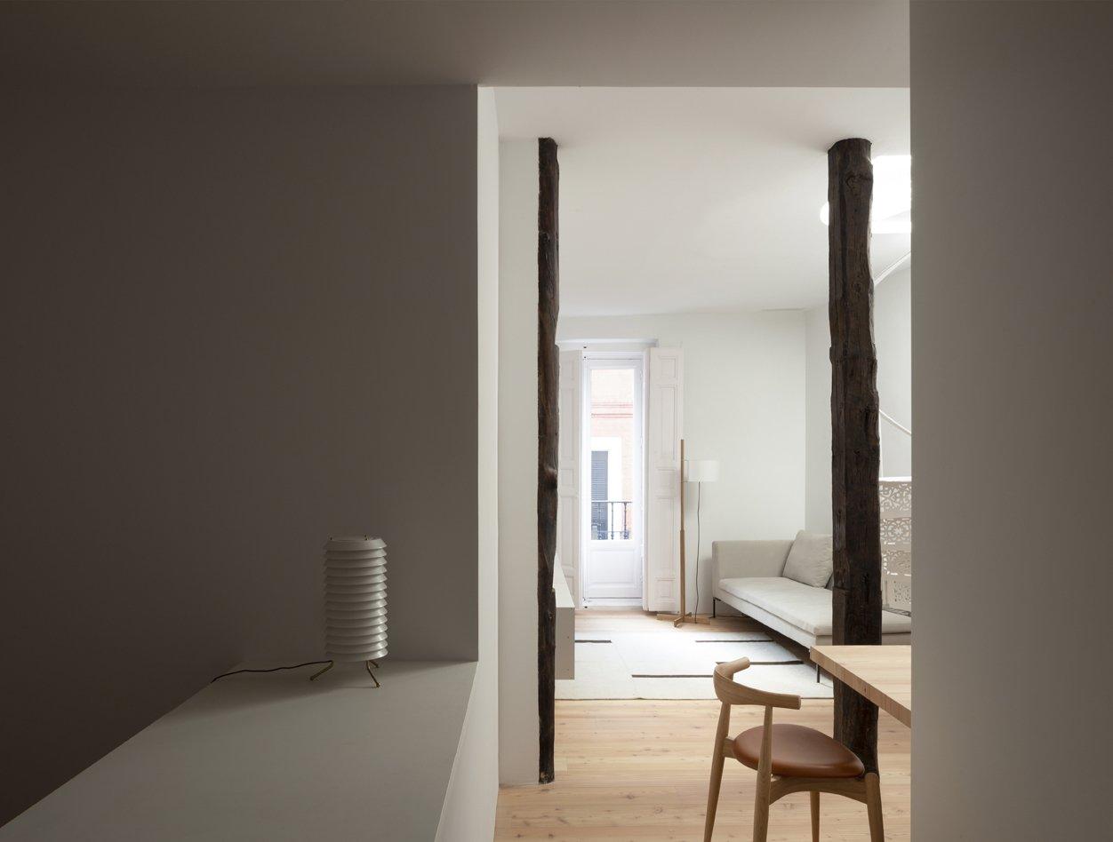 Living Room, Table, Chair, Floor Lighting, Table Lighting, Light Hardwood Floor, and Sofa  Ana Apartment