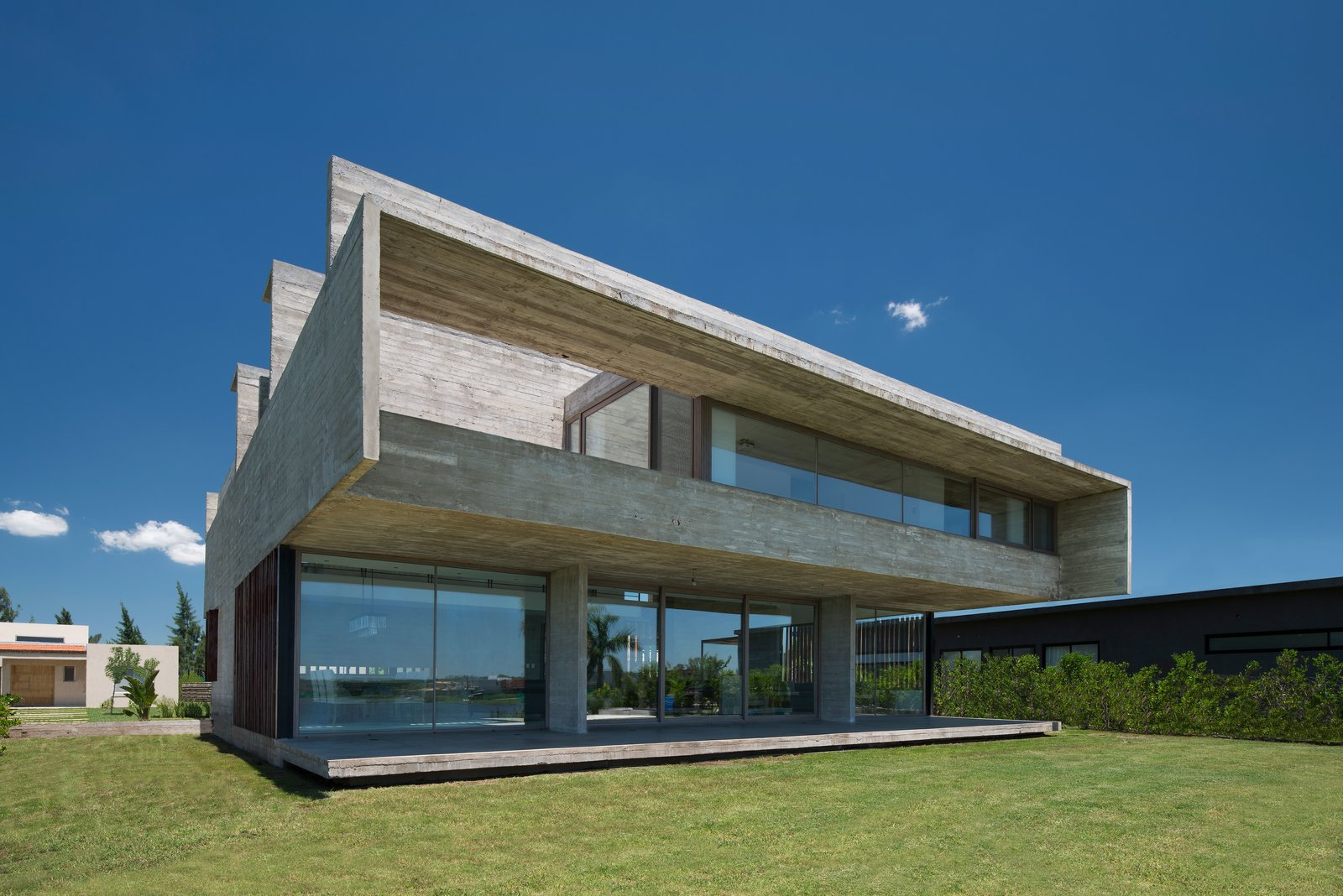 Exterior, House Building Type, Concrete Siding Material, and Flat RoofLine  10 House by Luciano Kruk arquitectos