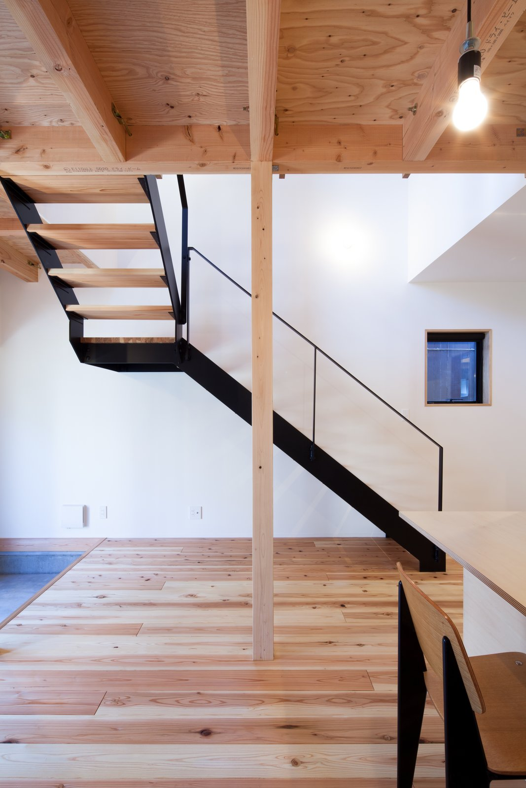 Living, Chair, Ceiling, Gas Burning, Concrete, Light Hardwood, and Standard Layout  Best Living Concrete Light Hardwood Photos from A-small-house-in-higashimurayama