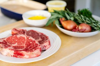 Lefebvre seasoned the rib-eye with salt and pepper, then seared them in clarified butter.