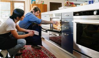 Lefebvre loads the water container into the steam oven. The Fisher & Paykel Built-In Combination Steam Oven is easy to install and doesn't require any plumbing. It can be installed nearly anywhere to suit your preferences and kitchen design.