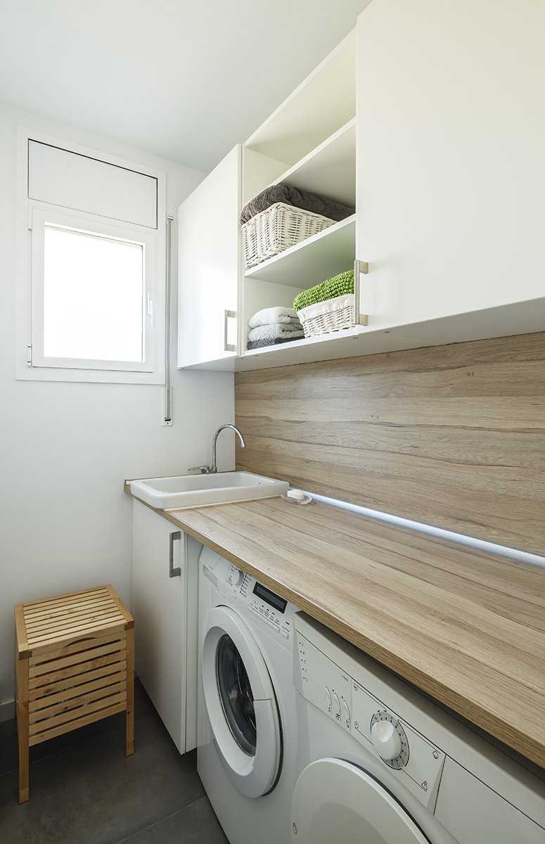 Laundry Room, White Cabinet, and Wood Counter  Sant Cugat, Catalunya, Spain