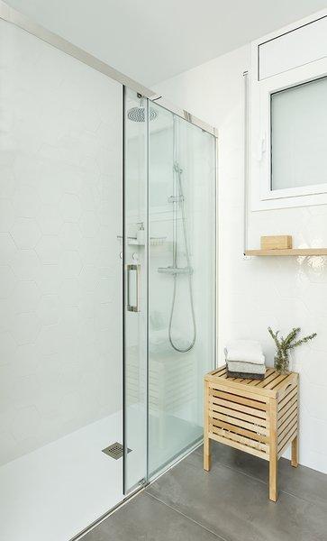 Bath Room, Freestanding Tub, Full Shower, Ceiling Lighting, Ceramic Tile Wall, Ceramic Tile Floor, One Piece Toilet, Open Shower, and Wood Counter  Sant Cugat, Catalunya, Spain