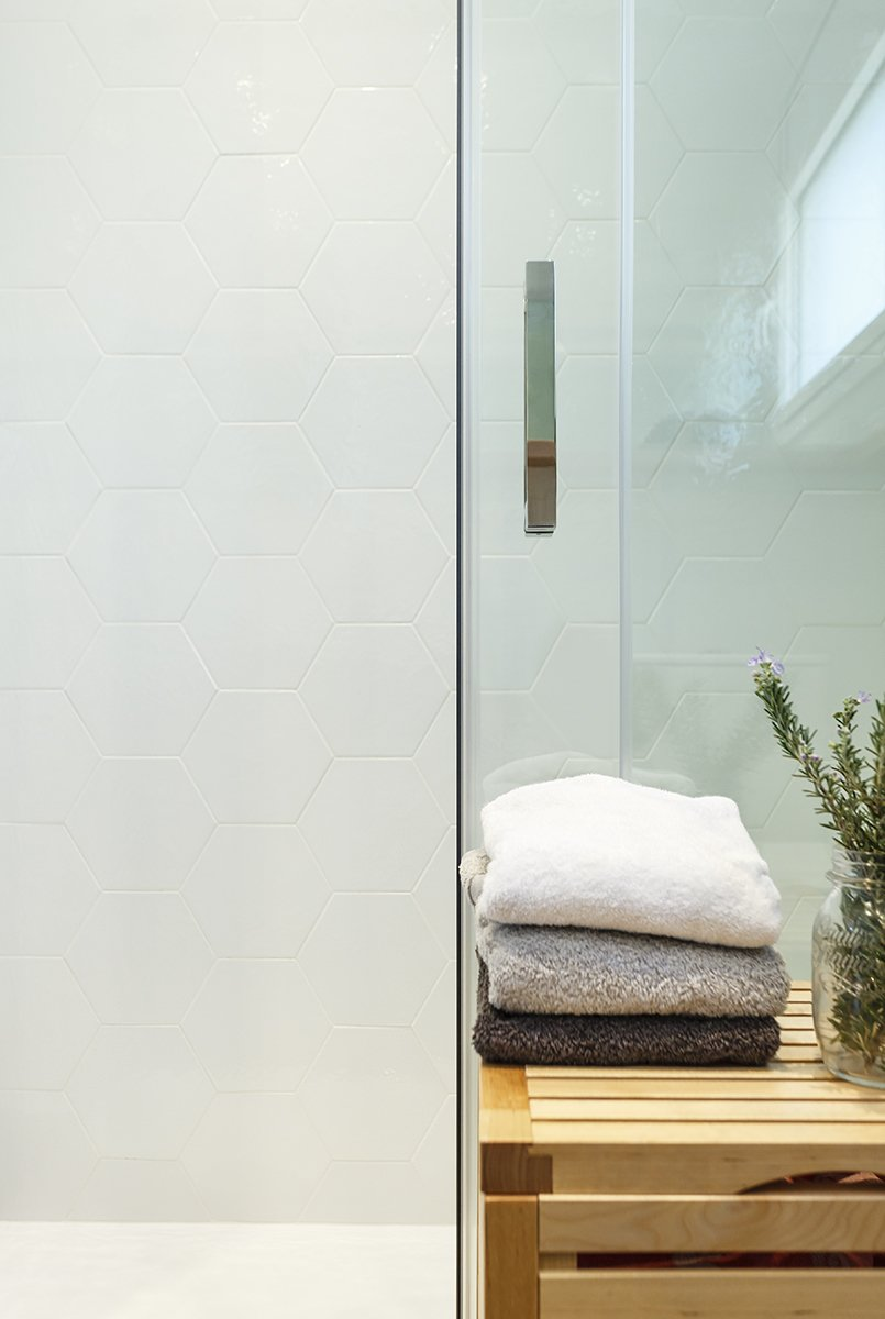 Bath Room, Freestanding Tub, One Piece Toilet, Ceramic Tile Floor, Ceiling Lighting, Ceramic Tile Wall, and Wood Counter  Sant Cugat, Catalunya, Spain