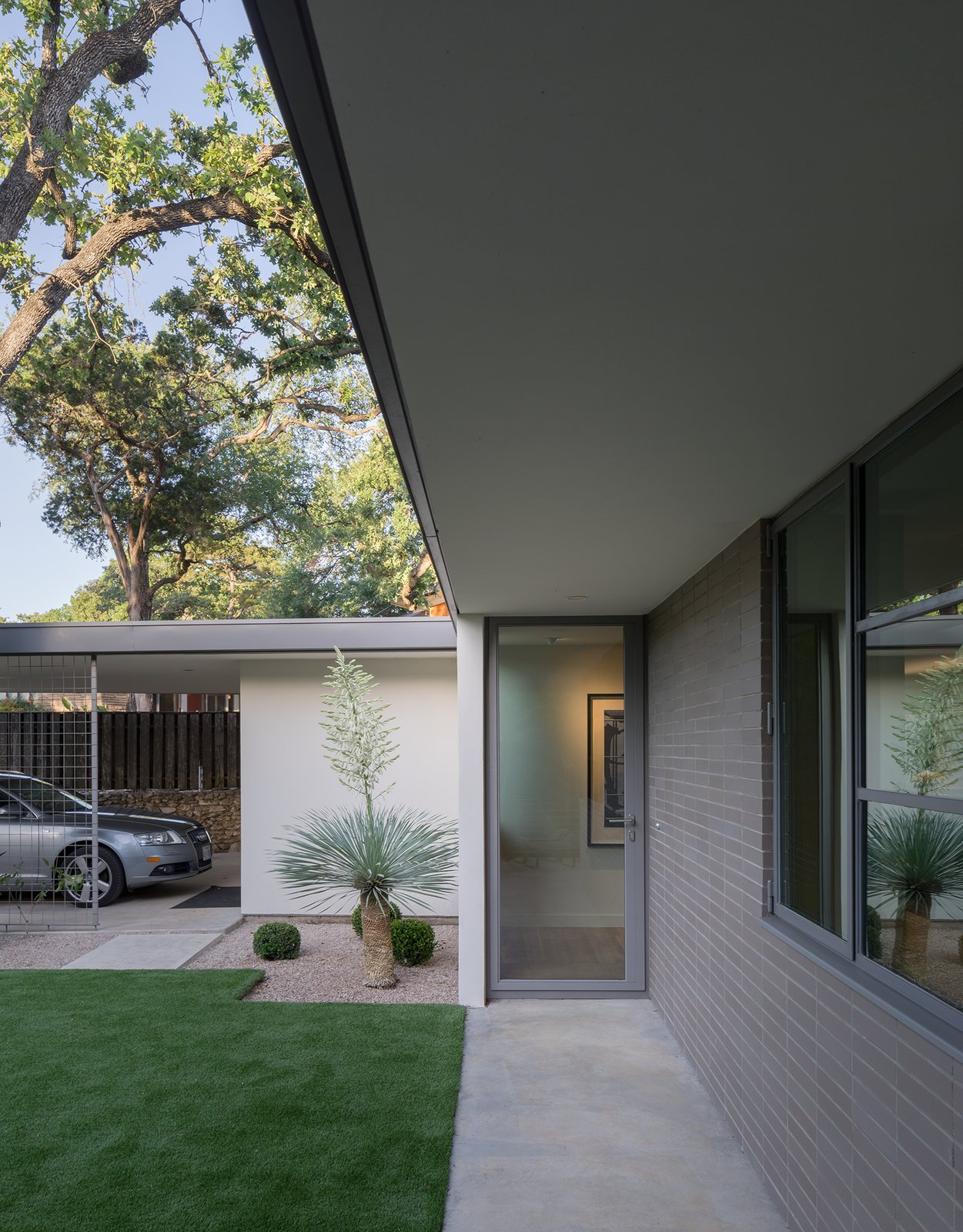 Exterior, Brick Siding Material, House Building Type, and Flat RoofLine  Inwood Place by Tim Cuppett Architects