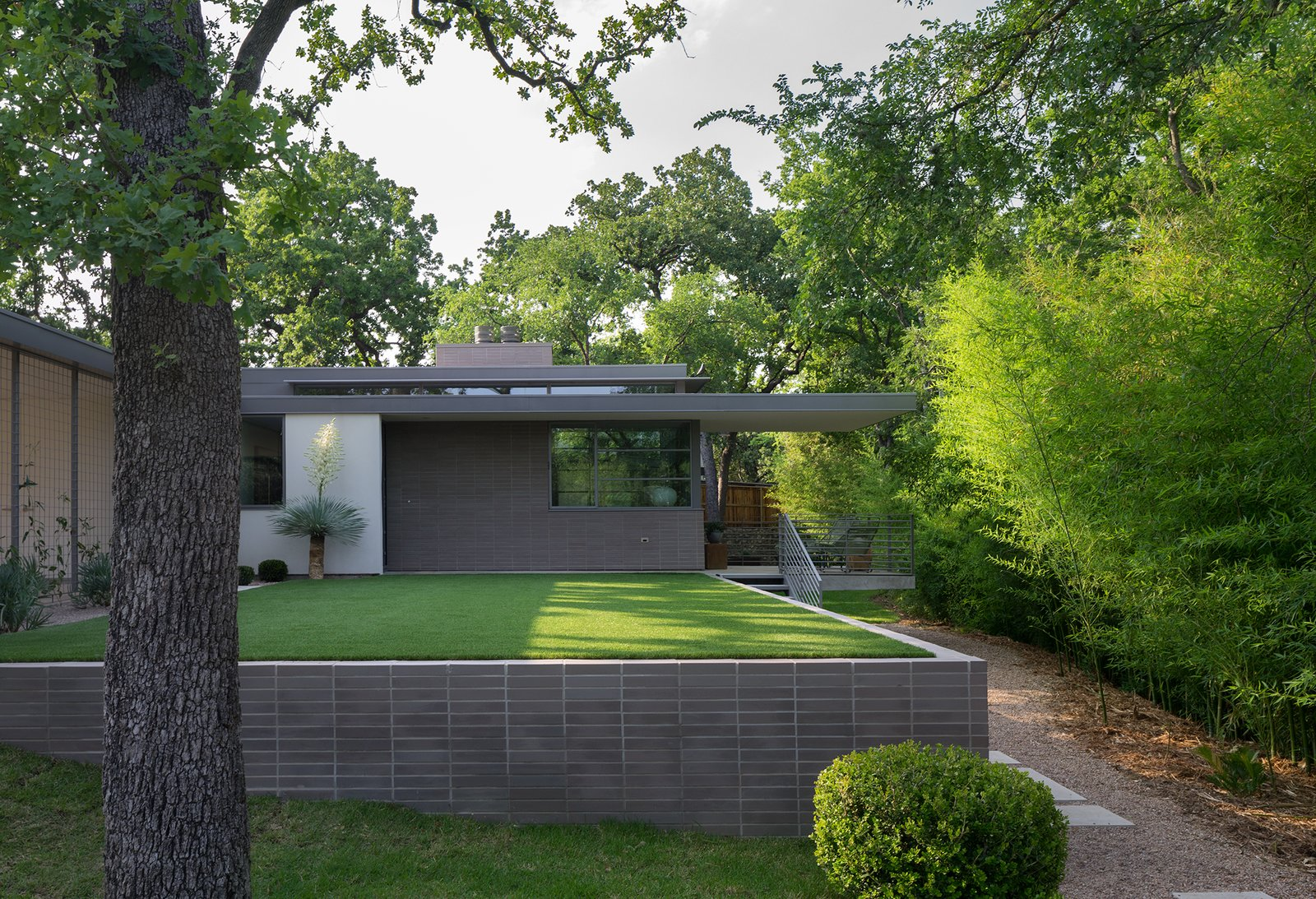 Exterior, House Building Type, Flat RoofLine, and Brick Siding Material  Inwood Place by Tim Cuppett Architects