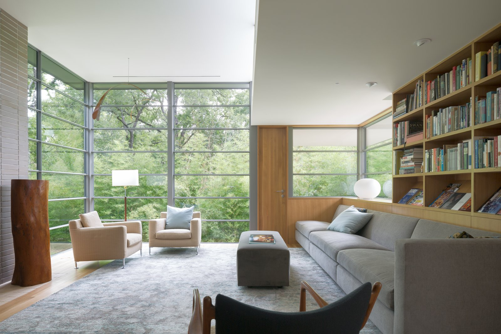 Living Room, Chair, Recessed Lighting, Light Hardwood Floor, Ottomans, and Sectional  Inwood Place by Tim Cuppett Architects