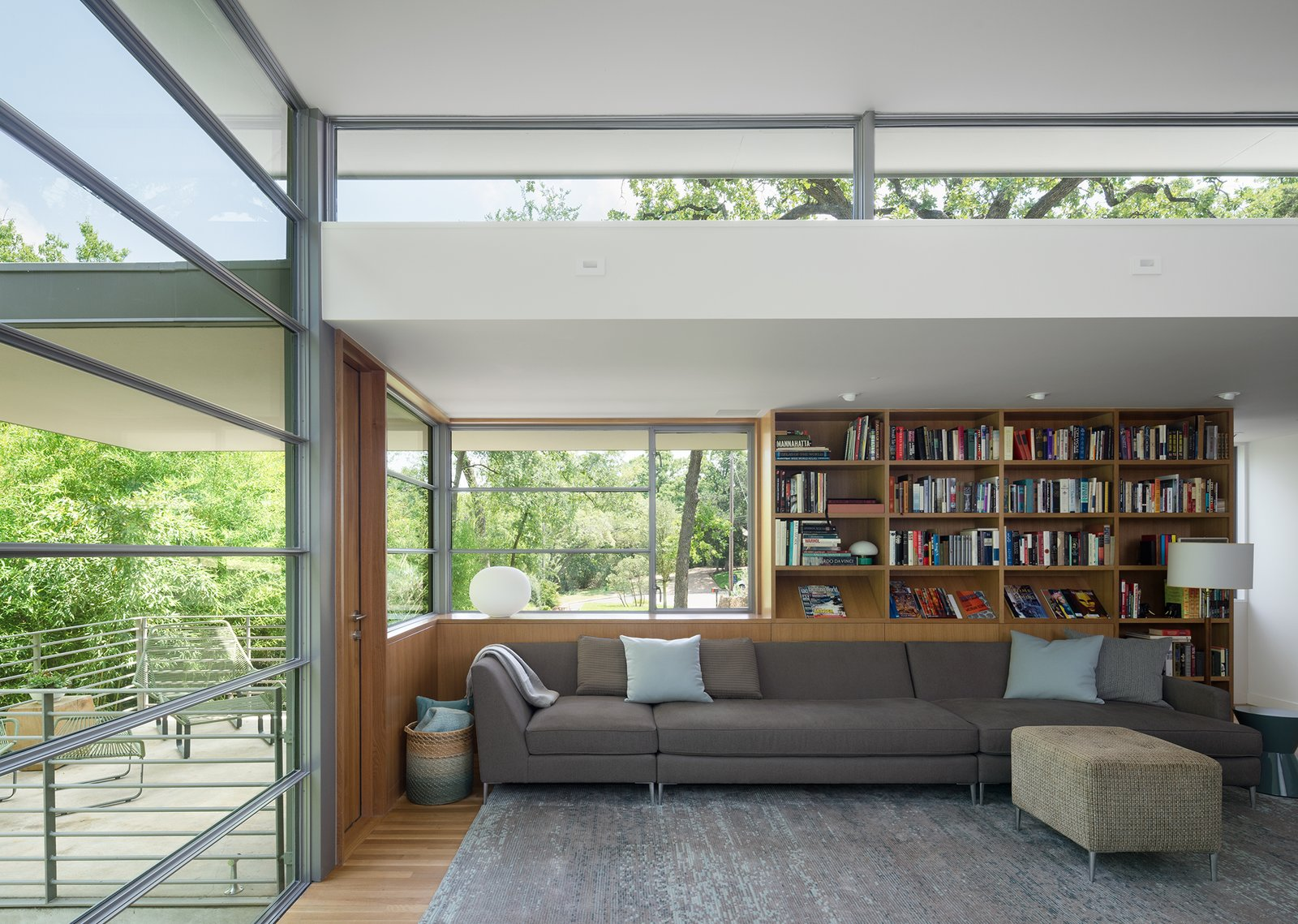 Living Room, Recessed Lighting, Ottomans, Light Hardwood Floor, and Sectional  Inwood Place by Tim Cuppett Architects